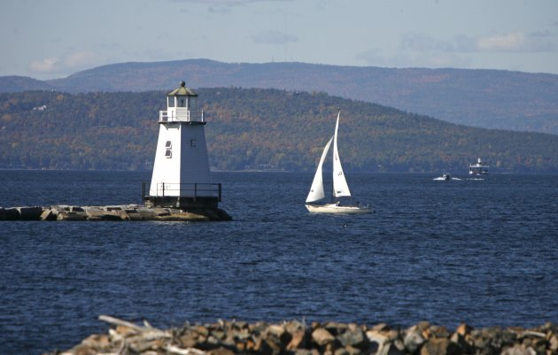 Boats travel across the waters of Lake Champlain in Burlington, Vt. (AP Photo/Toby Talbot)