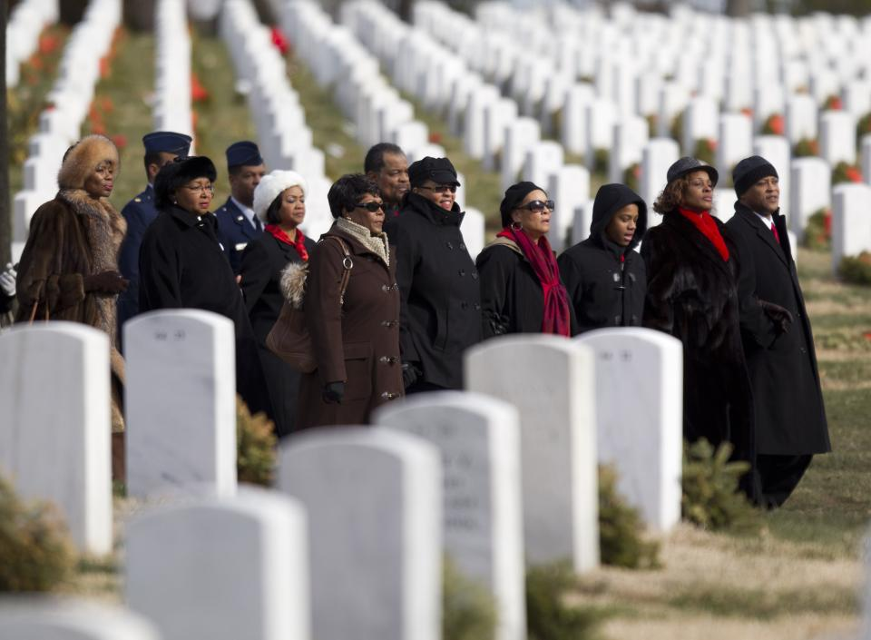 Friends and family of former Tuskegee airman, retired Lt. Col. Luke Weathers arrive for burial services at Arlington National Cemetery in Arlington, Va., Friday, Jan. 20, 2012.  (AP Photo/Evan Vucci)