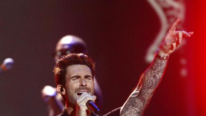 """FILE - In a Wednesday, Dec. 5, 2012 file photo, Adam Levine, of the musical group Maroon 5, performs at the Grammy Nominations Concert Live! at Bridgestone Arena, in Nashville, Tenn. Broadcast Music, Inc. announced Monday, April 8, 2013 that Levine will receive the president's award at the 61st annual BMI Pop Awards on May 14. BMI says it is honoring 34-year-old Levine because of his """"outstanding achievements in songwriting and the global impact he has had on pop culture."""" (Photo by Wade Payne/Invision/AP, File)"""