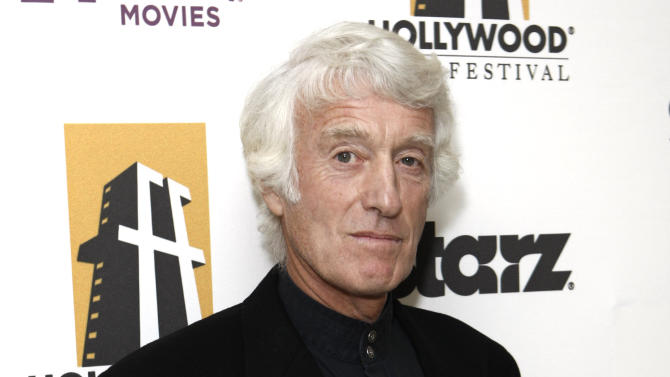 FILE - In this Oct. 26, 2009 file photo, Roger Deakins poses with his award for best cinematographer backstage at the 13th Annual Hollywood Awards Gala, in Beverly Hills, Calif. (AP Photo/Matt Sayles, File)