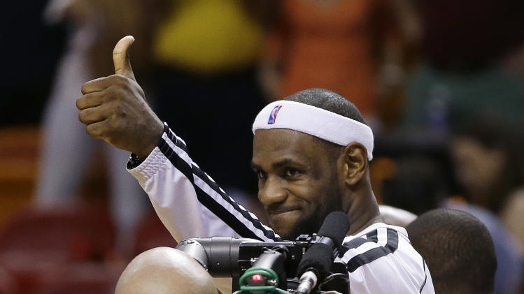 Miami Heat's LeBron James celebrates after the Heat defeated the Charlotte Bobcats during a NBA basketball game in Miami, Sunday, March 24, 2013. The Heat won 109-77 for their 26th victory in a row.  (AP Photo/J Pat Carter)