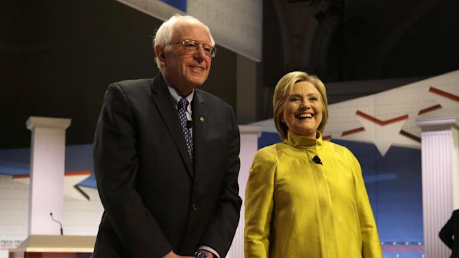 Democratic presidential candidates Sen. Bernie Sanders, I-Vt, left, and Hillary Clinton smile as they take the stage before a Democratic presidential primary debate at the University of Wisconsin-Milwaukee, Thursday, Feb. 11, 2016, in Milwaukee. (AP Photo/Tom Lynn)
