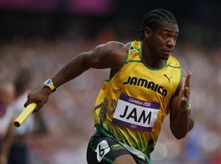 Jamaica's Yohan Blake runs in the men's 4x100m relay round 1 heat at the London 2012 Olympic Games at the Olympic Stadium