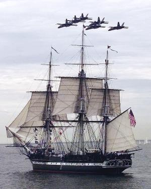 "FILE - In this July 21, 1997 file photo, the Blue Angels fly in formation over the USS Constitution as she free sails off the coast of Marblehead, Mass., in celebration of her 200th birthday.  The frigate, nicknamed ""Old Ironsides,"" had not sailed on her own for more than 116 years.  On Sunday, Aug. 19, 2012, the ship is scheduled to again raise sails on a cruise to mark the day two centuries ago when the Constitution bested the British frigate HMS Guerriere in a fierce battle during War of 1812. (AP Photo/Charles Krupa, File)"