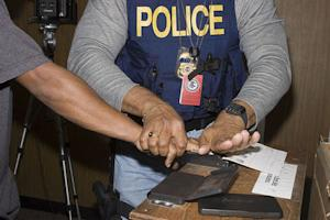 """Police officer (U.S.) taking fingerprints"""