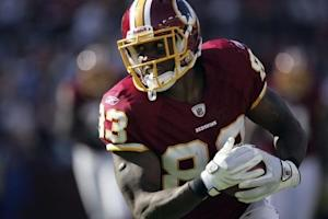 Davis turns to run after a catch against the New York Jets during the first half of their NFL football game in Landover