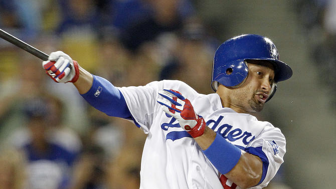 FILE - In this Aug. 8, 2012, file photo, Los Angeles Dodgers' Shane Victorino follows through on a single against the Colorado Rockies in a baseball game at Dodger Stadium in Los Angeles. Victorino and the Boston Red Sox are close to completing a three-year deal worth $39 million, a person familiar with the talks told The Associated Press on Tuesday, Dec. 4, 2012. The person, speaking at the baseball winter meetings under condition of anonymity because the contract wasn't finalized, said paperwork for the contract was being completed. (AP Photo/Reed Saxon, File)