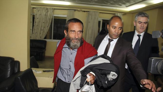 Freed hostage Daniel Larribe arrives at the airport in Niamey