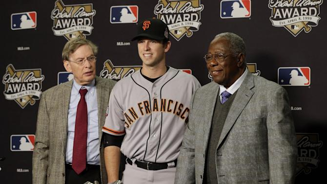 San Francisco Giants catcher Buster Posey poses with Major League Baseball Commissioner Bud Selig, left, and Hank Aaron as he receives National League Hank Aaron Award before Game 3 of baseball's World Series between the Detroit Tigers and the San Francisco Giants Saturday, Oct. 27, 2012, in Detroit. (AP Photo/Patrick Semansky)
