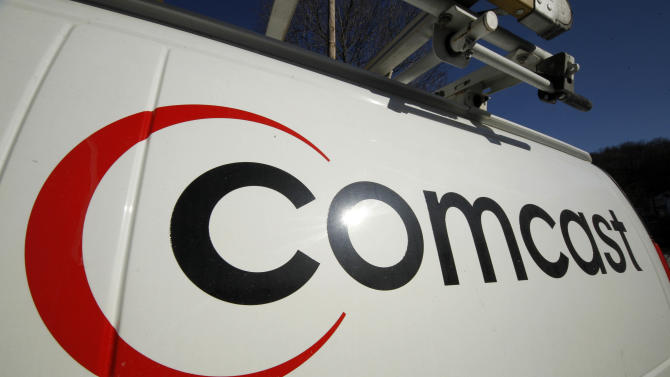 """FILE - This Feb. 11, 2011 file photo shows the logo on a Comcast truck in Pittsburgh.    Comcast reported on Wednesday Aug. 1, 2012 strong second-quarter earnings  from cable operations which overcame returns of the box-office flop """"Battleship.""""   (AP Photo/Gene J. Puskar, file)"""