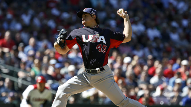 United States' Derek Holland (45) throws a pitch against Canada in the second inning during a World Baseball Classic baseball game on Sunday, March 10, 2013, in Phoenix. (AP Photo/Ross D. Franklin)