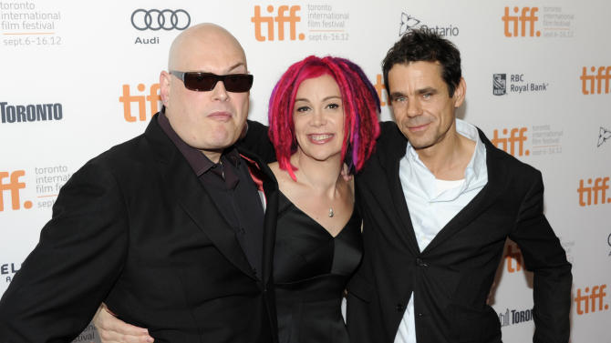 """Co-directors Andy Wachowski, left, Lana Wachowski and Tom Tykwer attend the premiere of """"Cloud Atlas"""" during the Toronto International Film Festival on Saturday Sept. 8, 2012 in Toronto. (Photo by Evan Agostini/Invision/AP)"""
