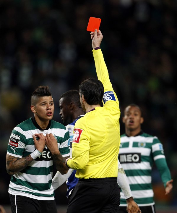 Sporting's Marcos Rojo receives red card from referee Paulo Batista during their Portuguese Premier League soccer match against Porto in Lisbon