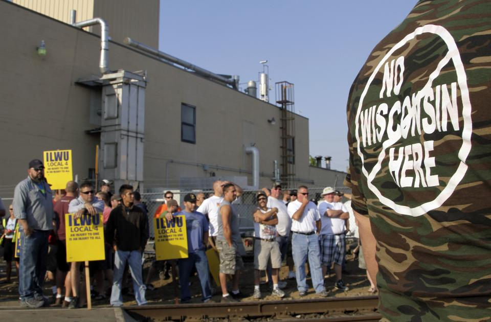 A crowd of union workers and supporters gather at a crossing in Vancouver, Wash. Wednesday, Sept. 7, 2011. Hundreds of Longshoremen were at the crossing as part of an escalating dispute about labor at the EGT grain terminal at the Port of Longview, Wash.(AP Photo/Don Ryan)