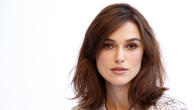 "In this Tuesday, Nov. 13, 2012 photo, actress Keira Knightley, from the film ""Anna Karenina,"" poses for a portrait in Los Angeles. Director Joe Wright gives the costume drama a modern spirit and the result is a fluid story that unfolds as much like dance as film, with a brisk pace compared to most period stories and contemporary sensibilities next to earlier takes on ""Anna Karenina,"" whose previous big-screen adaptations have featured Greta Garbo and Vivien Leigh.  (Photo by Matt Sayles/Invision/AP)"