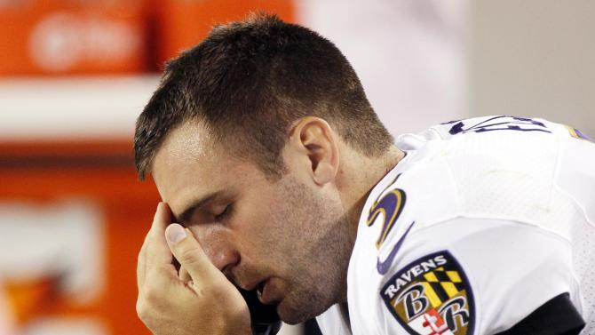 Baltimore Ravens quarterback Joe Flacco talks on the phone on the sidelines in the fourth quarter in their NFL football game against the Denver Broncos in Denver