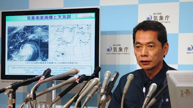 Japanese meteorologist Satoshi Ebihara answers questions during a press conference in Tokyo, on July 7, 2014