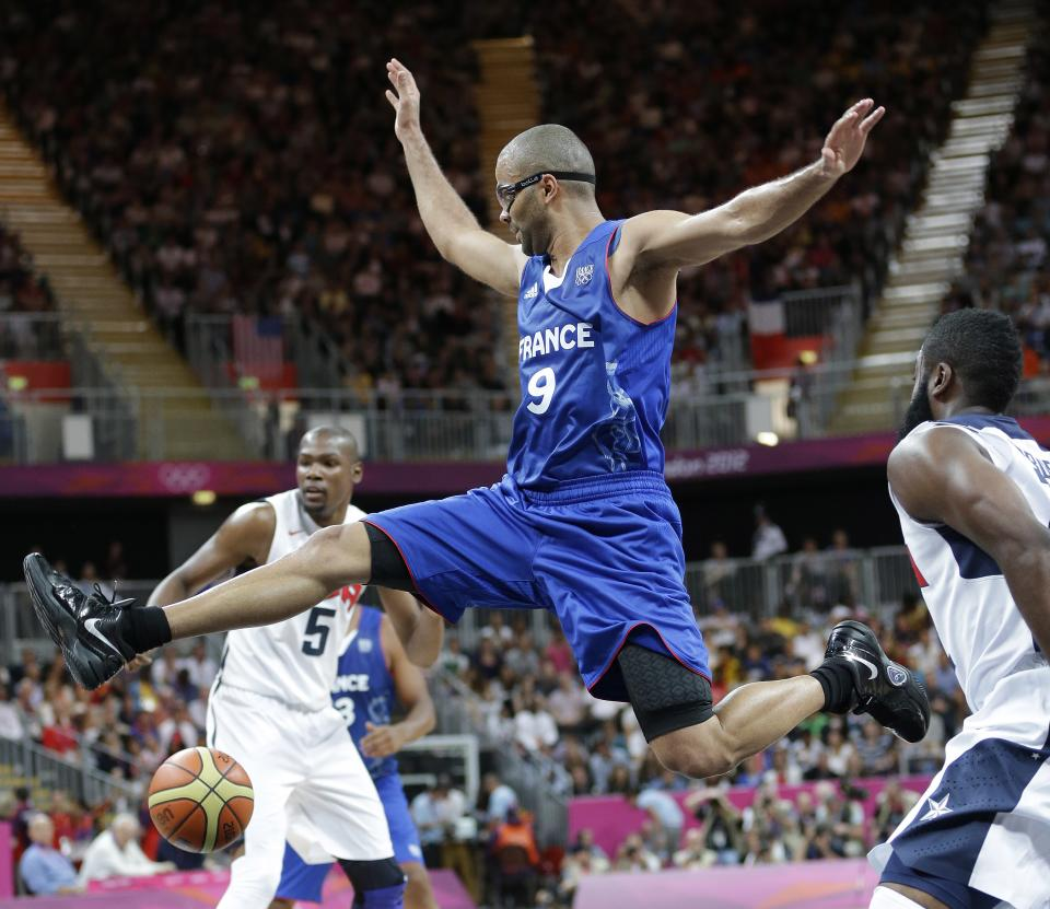 United States' James Harden, right, strips the ball from France's Tony Parker (9) during the first half of a preliminary men's basketball game at the 2012 Summer Olympics, Sunday, July 29, 2012, in London. (AP Photo/Eric Gay)