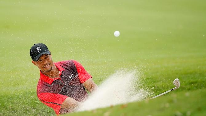 Tiger Woods plays a bunker shot during the final round of the Hero World Challenge on December 7, 2014 in Windermere, Florida