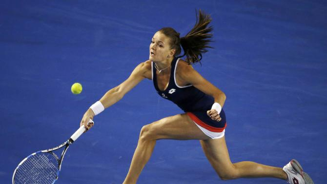 Radwanska of Poland hits a return to Venus of the U.S. during their women's singles match at the Australian Open 2015 tennis tournament in Melbourne