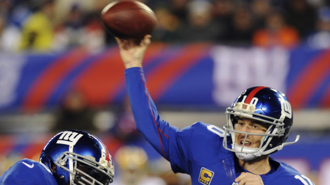 New York Giants quarterback Eli Manning (10) throws a pass as Green Bay Packers' Dezman Moses (54) rushes during the first half of an NFL football game, Sunday, Nov. 25, 2012, in East Rutherford, N.J. (AP Photo/Bill Kostroun)