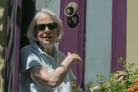 The mother of American writer Peter Theo Curtis briefly answers reporters' questions outside her home in Cambridge, Massachusetts