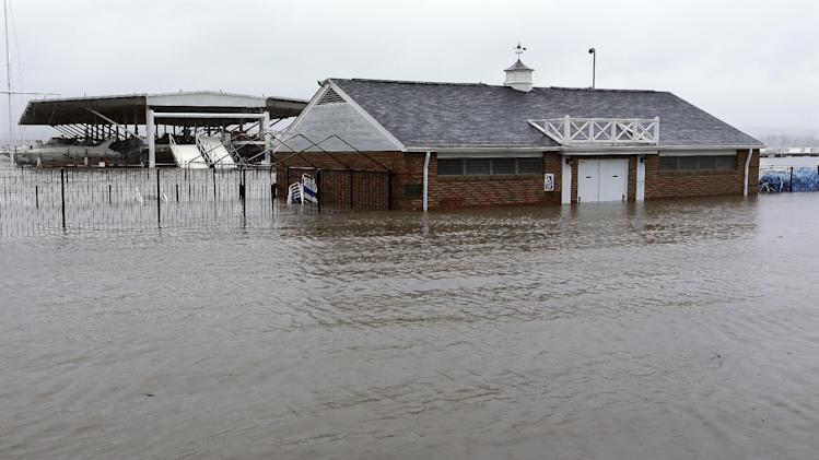 The clubhouse of the Illinois Valley Yacht and Canoe Club is surrounded by water as the Illinois River   Tuesday, April 23, 2013, in Peoria Heights, Ill. Floodwaters are rising to record levels along the Illinois River in central Illinois.   (AP Photo/Seth Perlman)