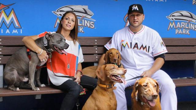 Baseball Player Won't Move Without Dog