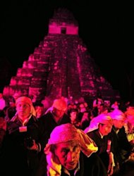 <p>Guatemalan Mayan natives take part in celebrations marking the end of the Mayan era at the Tikal archaeological site, 560 kms north of Guatemala City, on December 21, 2012. A global day of lighthearted doom-themed celebration and superstitious scare-mongering culminated Friday in the jungle temples built by the Mayan people of Central America, whose calendar sparks fears of apocalypse.</p>