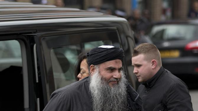 Abu Qatada, center, gets out the back of a vehicle as he arrives back at his residence in London, Tuesday, Nov. 13, 2012.  The radical Islamist cleric described by prosecutors as a key al-Qaida operative in Europe was freed from prison Tuesday after a court ruled he cannot be deported from Britain to Jordan to face terrorism charges.  (AP Photo/Matt Dunham)