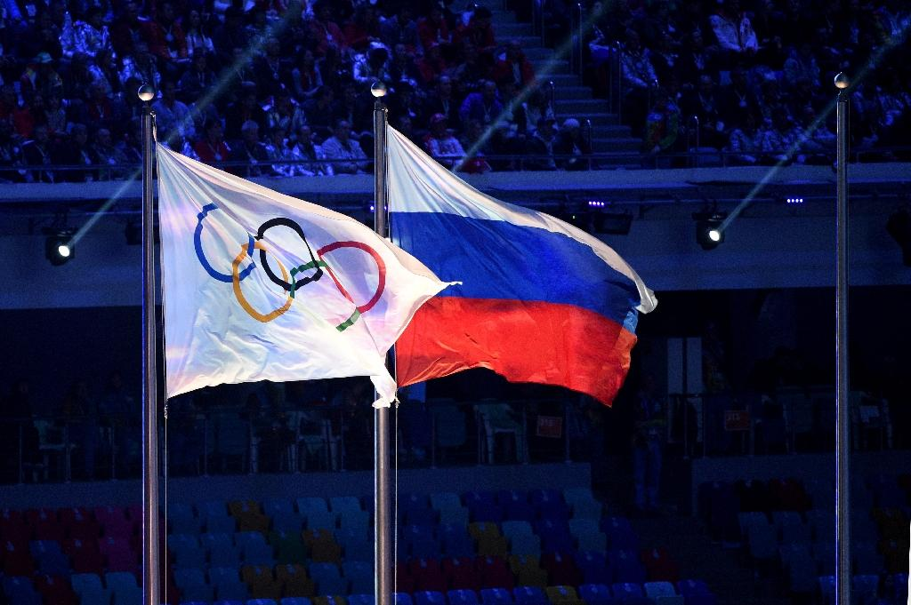 Russia says 8 athletes in 2012 Olympics positive after retests