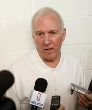 San Antonio Spurs head coach Gregg Popovich talks to reporters before an NBA basketball game against the Miami Heat, Thursday, Nov. 29, 2012, in Miami. ( AP Photo/Alan Diaz)