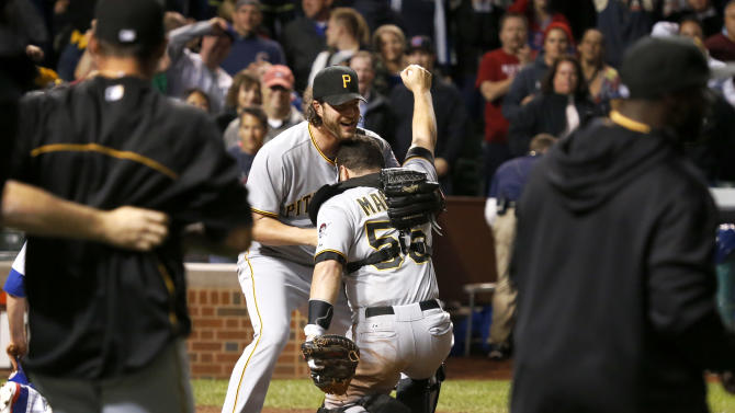 Pittsburgh Pirates relief pitcher Jason Grilli, left, picks up catcher Russell Martin after a baseball game and Pirates 2-1 win over the Chicago Cubs Monday, Sept. 23, 2013, in Chicago. (AP Photo/Charles Rex Arbogast)