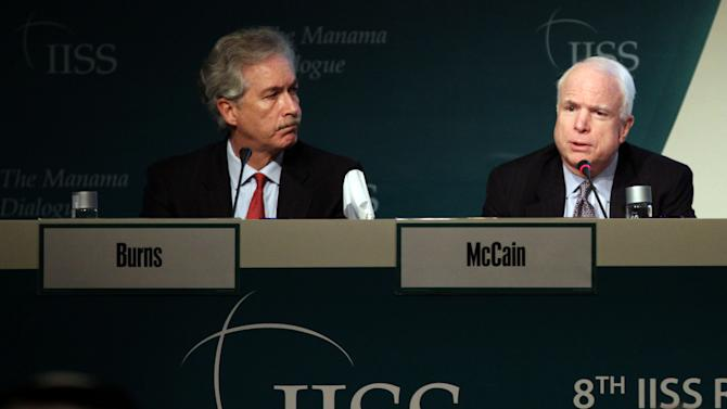 Deputy Secretary of States William Burns, left, and Sen. John McCain, right, answer questions during the International Institute of Strategic Studies (IISS) conference in Manama, Bahrain, Saturday, Dec. 8, 2012. The IISS Manama conference will discuss the security situation in the Syrian region among other topics. (AP Photo/Hasan Jamali)