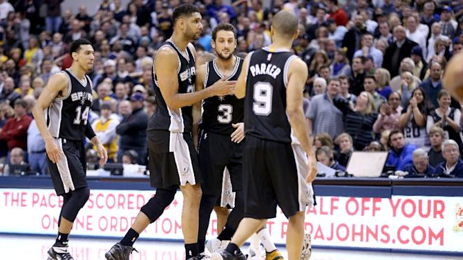 San Antonio Spurs' Tim Duncan hugs teamamte Marco Belinelli during a game at Bankers Life Fieldhouse on February 9, 2015