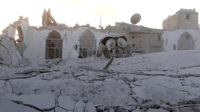 In this Thursday November 1, 2012 citizen journalism image, provided by Edlib News Network, ENN, which has been authenticated based on its contents and other AP reporting, shows a mosque  which was destroyed in shelling by Syrian forces loyal to Syrian President Bashar Assad, in the  village of Taftanaz, Idlib province, northern Syria. Syrian rebels killed more than 75 soldiers on Thursday, about half of them in attacks on military checkpoints in the north just hours after a wave of bombings hit the Damascus area, activists said. The unusually high toll for regime forces came after days of intense air bombardment of rebel positions around the country that killed hundreds. (AP Photo/Edlib News Network ENN)