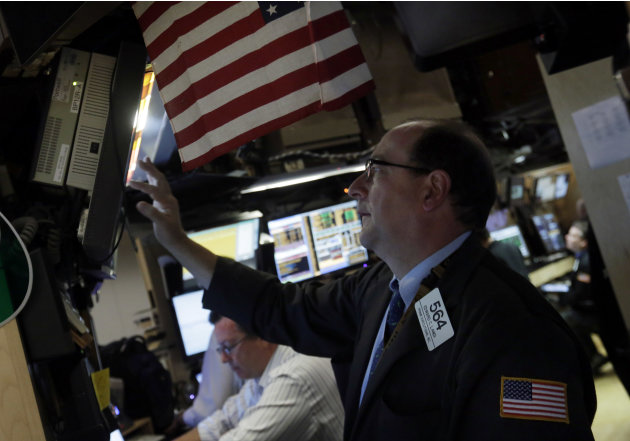 In this Monday, June 10, 2013 photo, trader Edward Landi check a screen in a booth on the floor of the New York Stock Exchange. Global stock markets traded fitfully Tuesday June 18, 2013 as investors