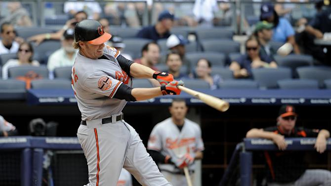 Baltimore Orioles' Mark Reynolds hits a three-run home run off New York Yankees starting pitcher Phil Hughes in the sixth inning of a baseball game on Sunday, Sept. 2, 2012, at Yankee Stadium in New York. (AP Photo/Kathy Kmonicek)