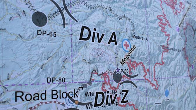 A map shows the progress of the Whitewater-Baldy fire and areas where crews are working to protect structures from the blaze burning south of Reserve, N.M., on Thursday, May 31, 2012. The fire has charred more than 190,000 acres to become the largest in New Mexico's recorded history. (AP Photo/Susan Montoya Bryan)