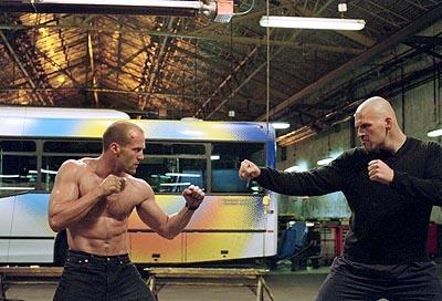 Jason Statham as Frank Martin busting out deadly street fighting and martial arts skills against a formidable opponent in 20th Century Fox's The Transporter