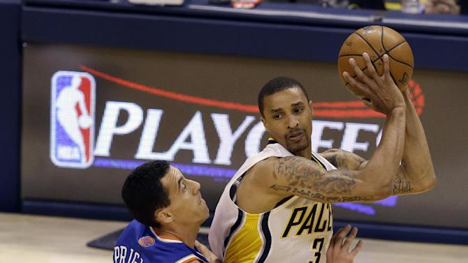 Indiana Pacers guard George Hill, right, is defended by New York Knicks guard Pablo Prigioni during the first half of Game 3 of the Eastern Conference semifinal NBA basketball playoff series in Indianapolis, Saturday, May 11, 2013. (AP Photo/Michael Conroy)