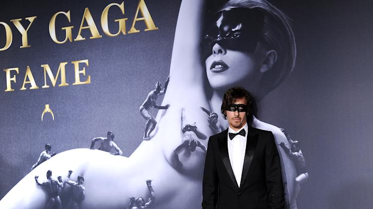 "Photographer Steven Klein arrives at a ""Lady Gaga Fame"" fragrance launch event at the Guggenheim Museum on Thursday, Sept. 13, 2012 in New York. The black tie masquerade event will feature a performance art piece by Lady Gaga, ""Sleeping with Gaga."" The film for ""Lady Gaga Fame"", directed by Steven Klein, will also be unveiled during the evening. (Photo by Evan Agostini/Invision/AP)"