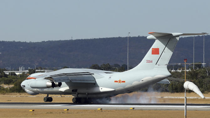 A Chinese Ilyushin IL-76 aircraft comes in for a landing at Perth International Airport after returning from the ongoing search operations for missing Malaysia Airlines Flight 370 in Perth, Australia, Thursday, April 10, 2014. With hopes high that search crews are zeroing in on the missing Malaysian jetliner's crash site, ships and planes hunting for the aircraft intensified their efforts Thursday after equipment picked up sounds consistent with a plane's black box in the deep waters of the Indian Ocean. (AP Photo/Rob Griffith)