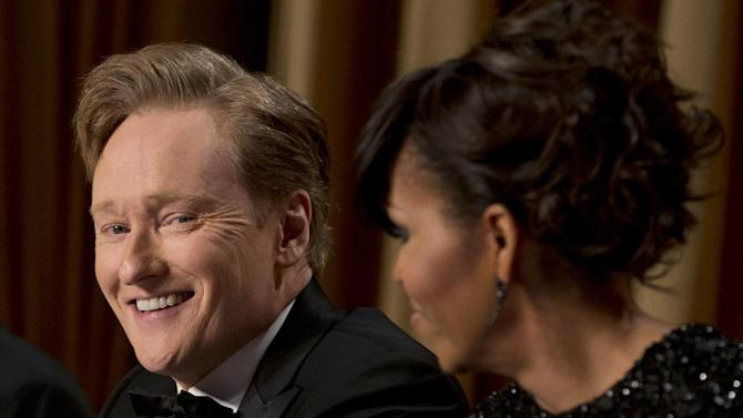 First lady Michelle Obama, right, and late-night television host Conan O'Brien attend the White House Correspondents' Association Dinner at the Washington Hilton Hotel, Saturday, April 27, 2013, in Washington.  (AP Photo/Carolyn Kaster)