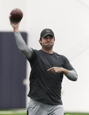 "Detroit Lions quarterback Shaun Hill practices at Detroit Country Day School in Beverly Hills, Mich., Tuesday, May 17, 2011. Hill wore a hat with the initials ""GU"" on it while at the Lions' informal workout Tuesday. It's in honor of Gene Upshaw, the former leader of the players' union who died in 2008. Hill's attire may have been coincidental, but the NFL's ongoing work stoppage was still hanging over the Lions when they worked out for about an hour at the school. (AP Photo/Carlos Osorio)"