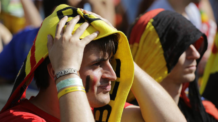 A Belgium soccer fan watches the World Cup quarterfinals match between Argentina and Belgium inside the FIFA Fan Fest area during the 2014 soccer World Cup in Sao Paulo, Brazil, Saturday, July 5, 2014. Argentina defeated Belgium 1-0 to reach the World Cup semifinals for the first time since 1990