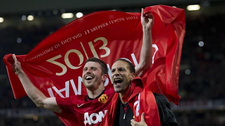 Manchester United's Rio Ferdinand, right, and Michael Carrick celebrate as they win their 20th English Premier League title after their 3-0 win over Aston Villa in their soccer match at Old Trafford Stadium, Manchester, England, Monday April 22, 2013. (AP Photo/Jon Super)