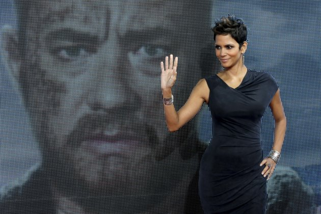 FILE - In this Nov. 5, 2012 file photo, Actress Halle Berry poses for the media in front of a video screen showing the face of actor Tom Hanks during her arrival for the European premiere of the movie 'Cloud Atlas' in Berlin. Berry and Chaka Khan will be honored at the 2013 BET Honors. The network announced Thursday, Dec. 20, 2012 that basketball star Lisa Leslie, music executive Clarence Avant and religious leader T.D. Jakes will also be celebrated at the Jan. 12 event in Washington, D.C at the Warner Theatre. (AP Photo/Michael Sohn)