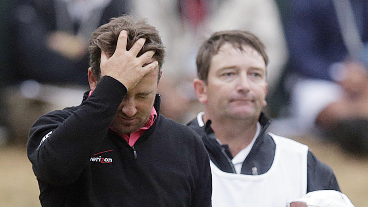 Graeme McDowell, of Northern Ireland, reacts as he walks off the 18th hole during the fourth round of the U.S. Open Championship golf tournament Sunday, June 17, 2012, at The Olympic Club in San Francisco. Webb Simpson won the tournament. (AP Photo/Charlie Riedel)