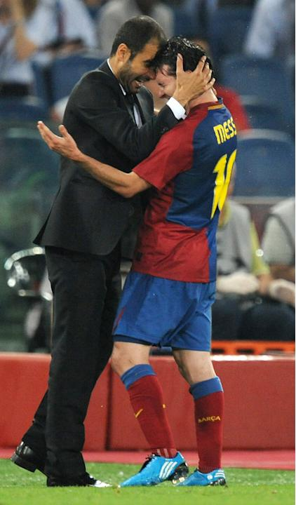 Barcelona´s Coach Josep Guardiola (L) Celebrating With Barcelona´s Argentinian Forward Lionel Messi At The End Of AFP/Getty Images